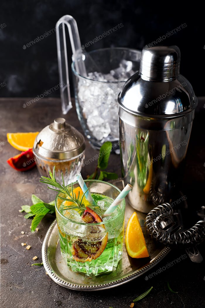tropical green cocktail with lemon and fresh rosemary