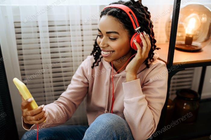 Attractive woman in headphones enjoys music
