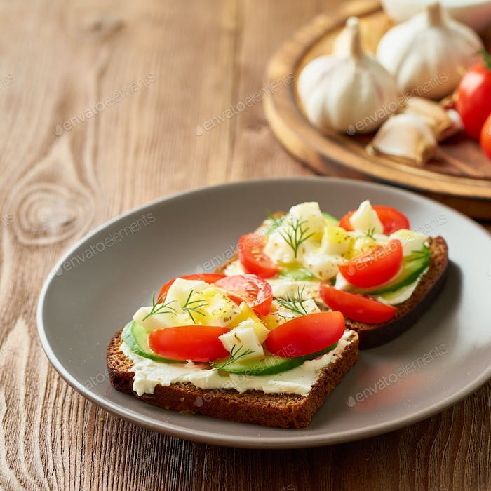Smorrebrod - traditional Danish sandwiches. Black rye bread with boiled egg