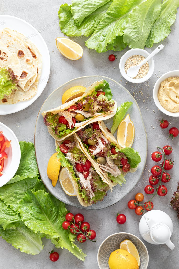 Tacos with chicken meat, salad and vegetables