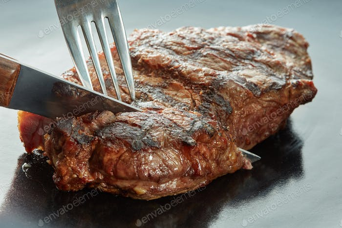 Macro of grilled meat on dark