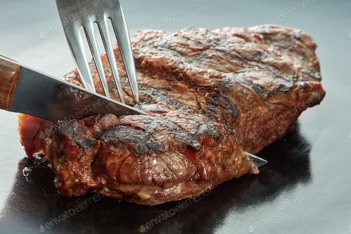 Macro of grilled meat on dark