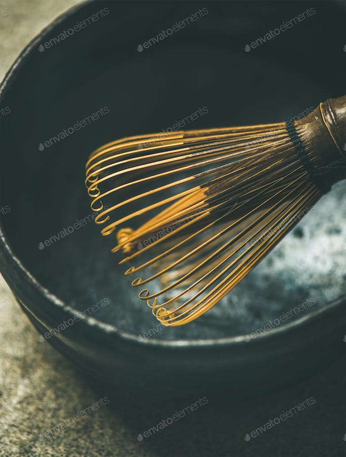 Close-up of traditional Japanese Chasen whisk and dark bowl