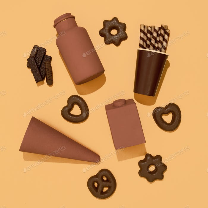 Chocolate objects and cookies. Sweets candy lover concept. Minimal art.