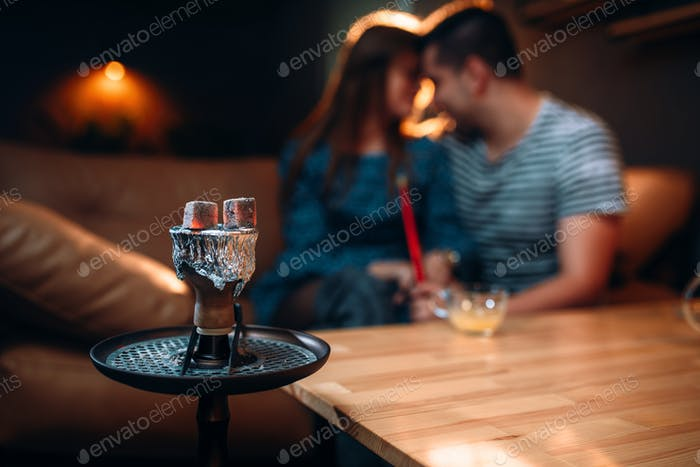 Young couple relax and smoking hookah