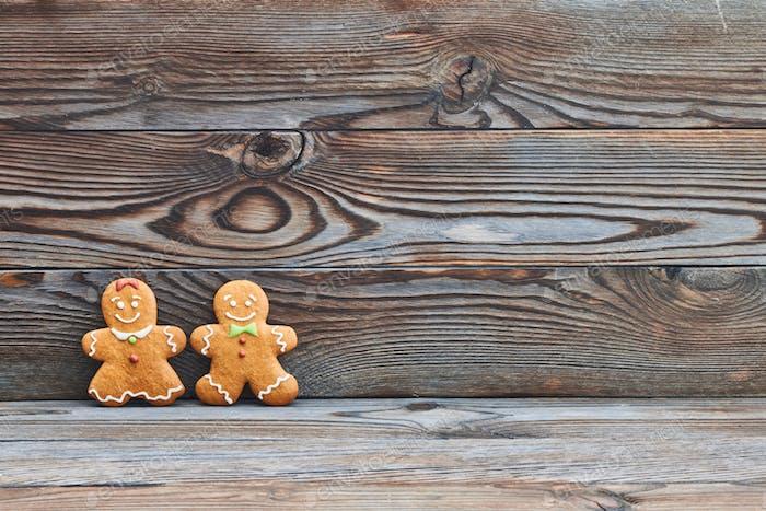 Christmas homemade gingerbread cookies, couple - man and woman.