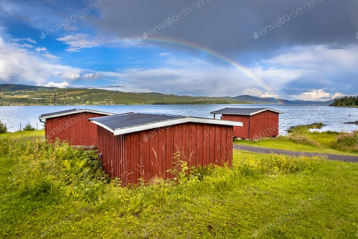 Traditional red wooden cabins in Norway