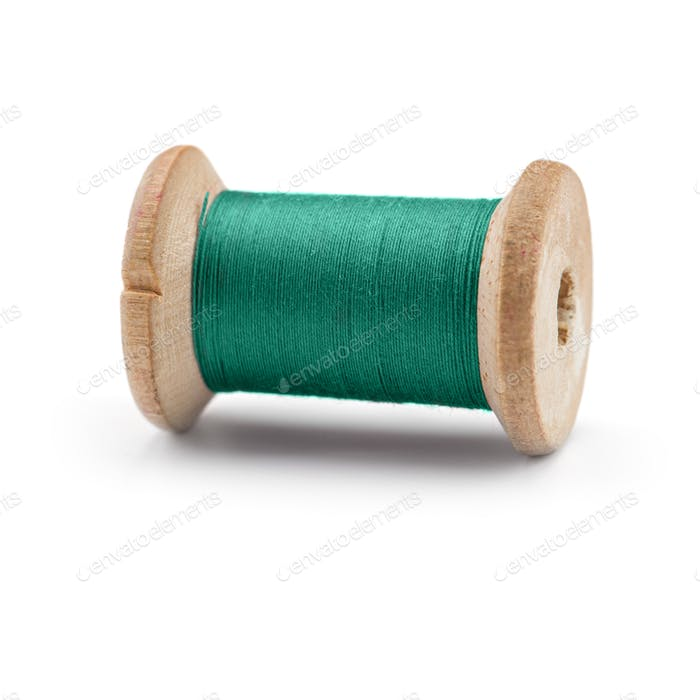 Colorful Spool sewing threads on white background