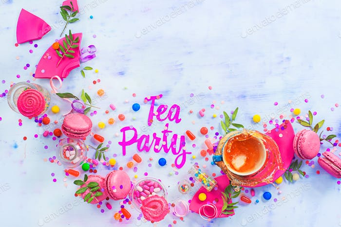 Tea party concept with paper text, candies, sweets, confetti, macarons and dynamic tea splash
