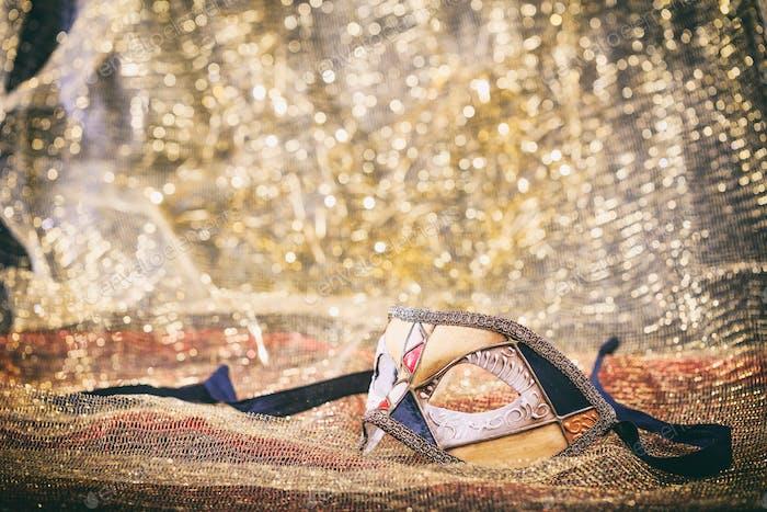 Carnival mask on golden blur background