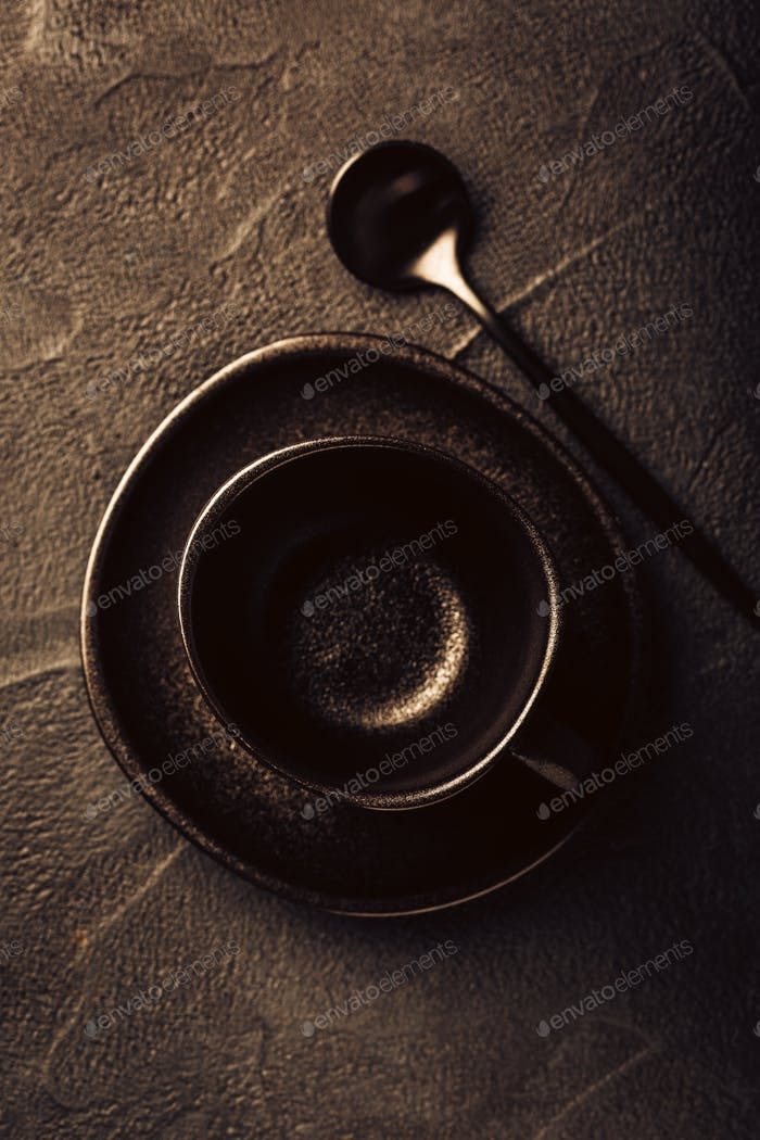 Black coffee cup, saucer and spoon