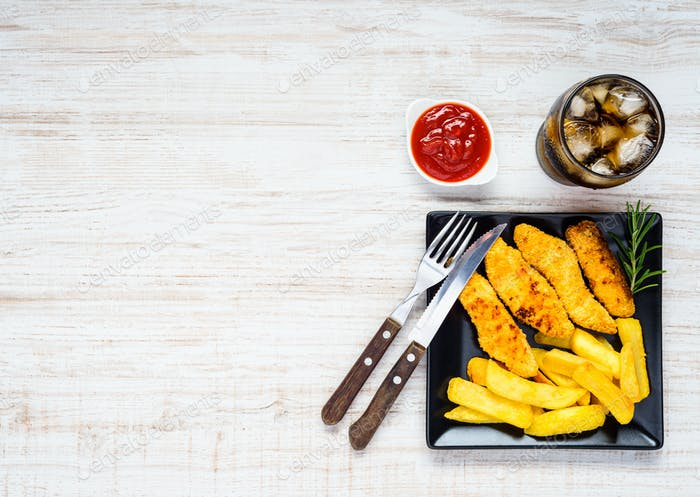 Fish Fingers with French Fries on Copy Space