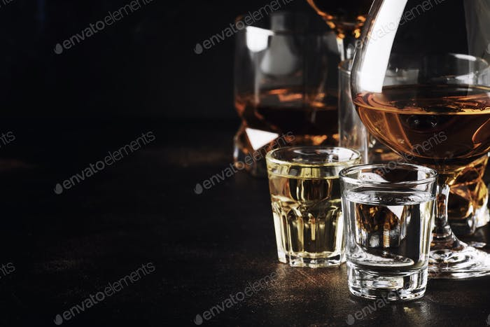 Set of strong alcoholic drinks in glasses