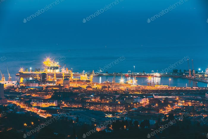 Batumi, Adjara, Georgia. Aerial View Of Urban Cityscape And Port At Evening Or Night. Industrial