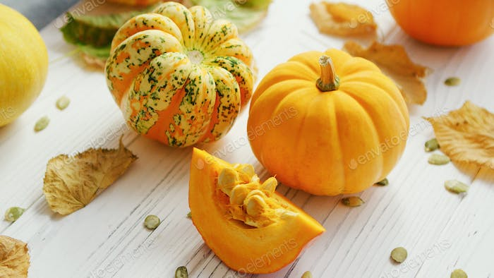 Yellow pumpkins and dried leaves