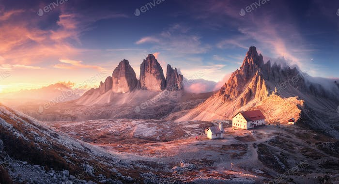 Mountain valley with beautiful house and church at sunset