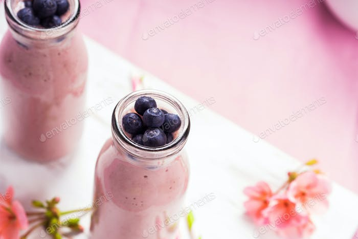 Strawberry banana smoothie topped with berries