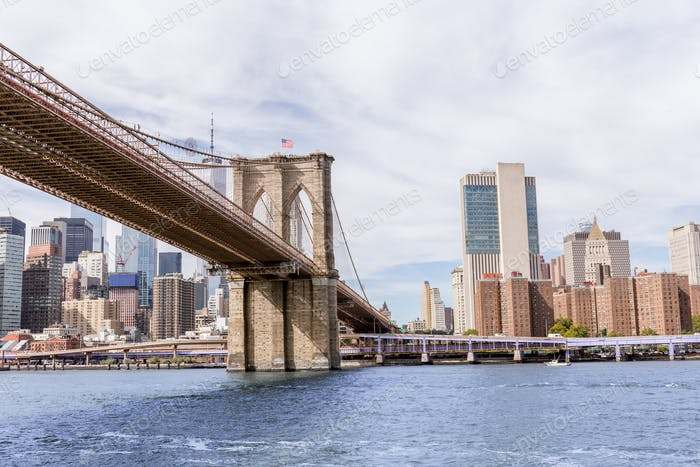urban scene with brooklyn bridge and manhattan in new york, usa