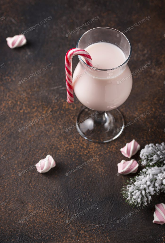 Pink Christmas cocktail with marshmallow