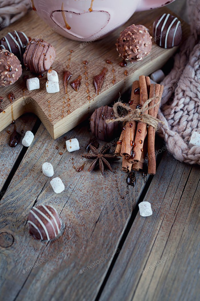 Christmas or New Year composition with hot chocolate and knitted scarf
