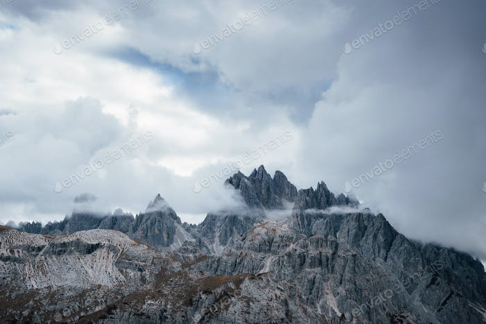Landscape of montains surrounded by fog and clouds