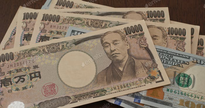 USD banknote and Japanese yen
