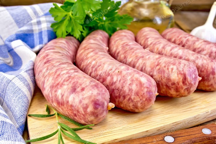 Sausages pork with rosemary on board