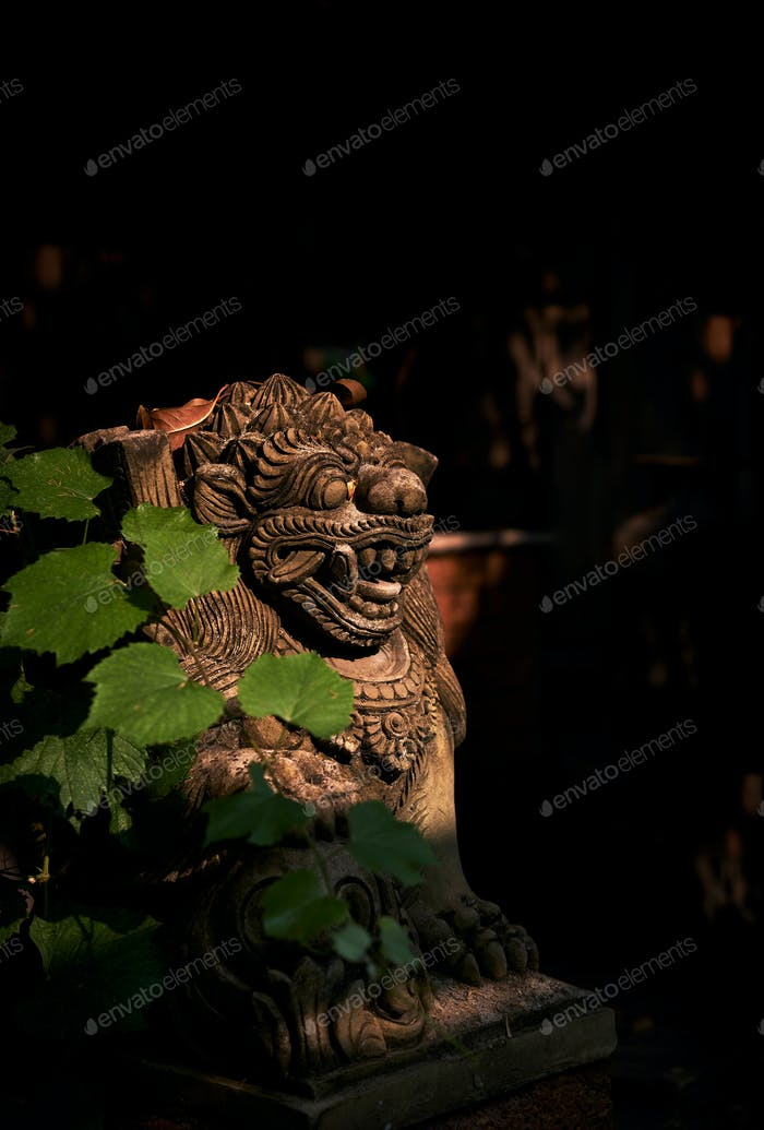 Bali lion statue in light and shadow