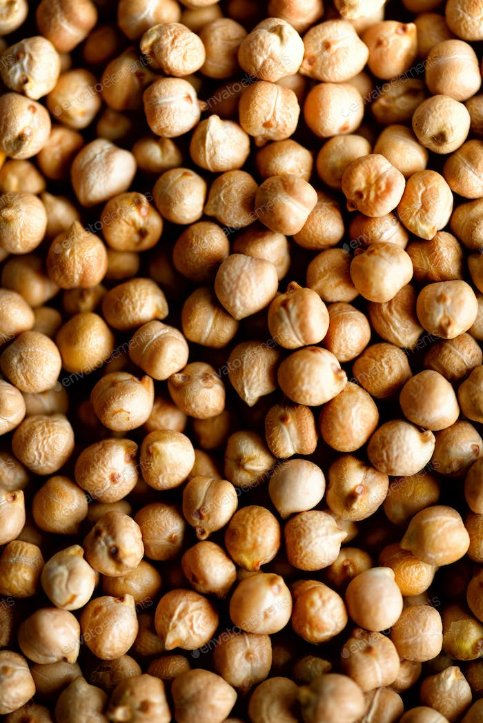 Raw organic dried chickpea texture background. Vegan healthy nutrition. Top view, copy space