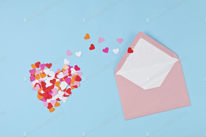 Hearts confetti and pink envelope. Love, valentine day, mothers day greeting card