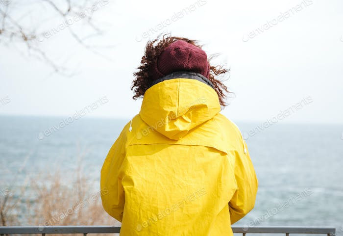 Photo of thinking woman near sea