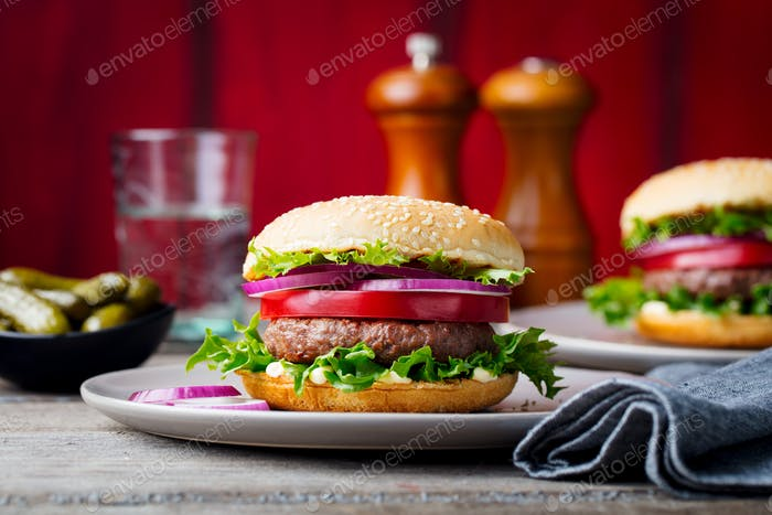 Burger on a Plate. Wooden Background.