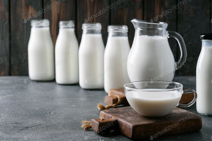 Fresh milk in different glass bottles