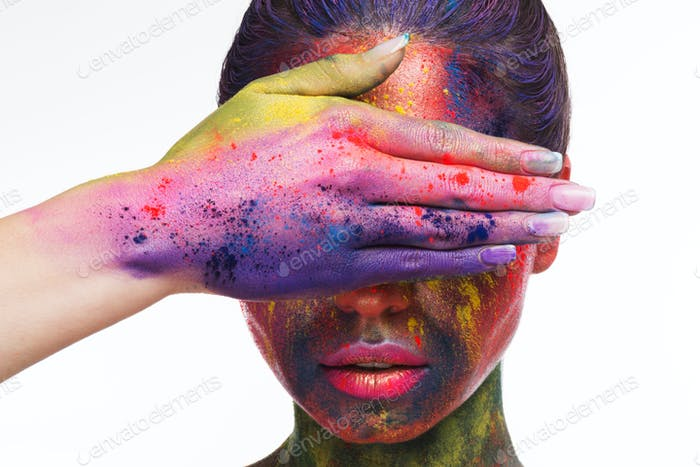 Fashion model woman with art makeup covering eyes