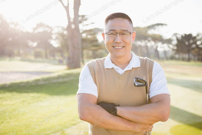Portrait of golfer posing with his arms crossed