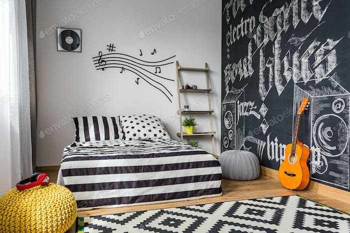 Monochrome bedroom for musician