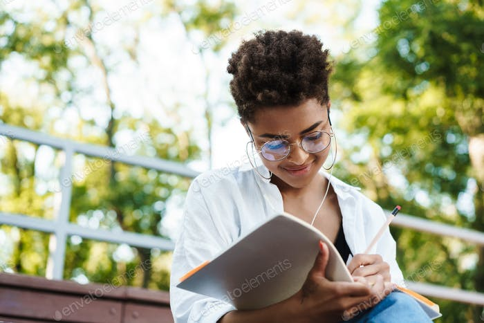 Concentrated african woman reading book