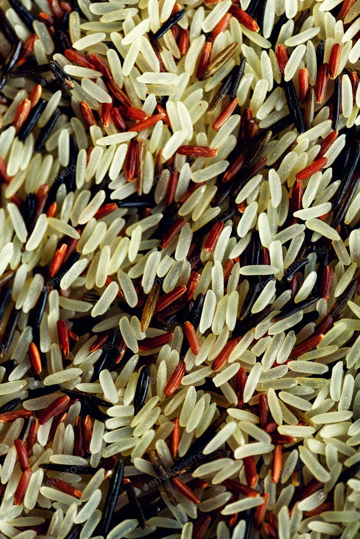 Raw organic rice berry and brown rice mixed texture. Food ingredient background. Top view, healthy