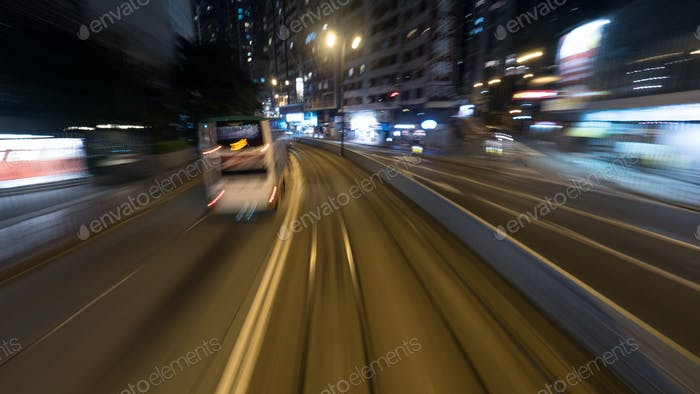 Traveling by tram in night Hong Kong