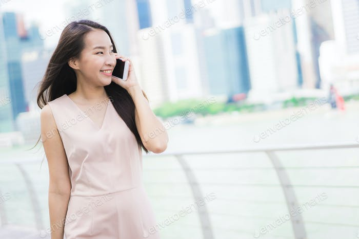Asian woman using smartphone or mobile phone for talking or text
