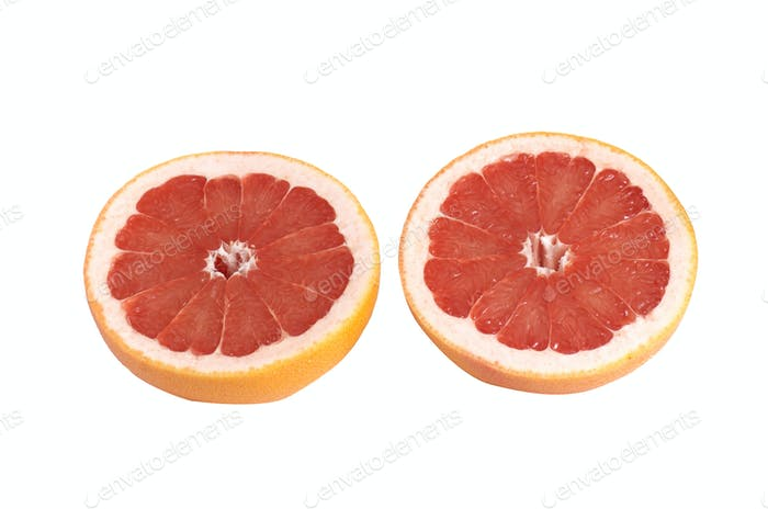 Juicy pieces of grapefruit on a white.