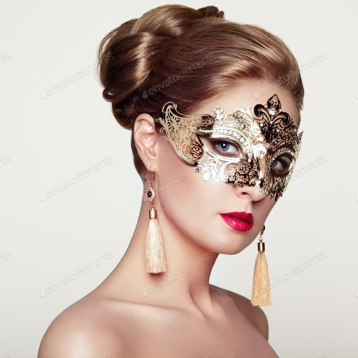 Beautiful woman in venetian masquerade mask