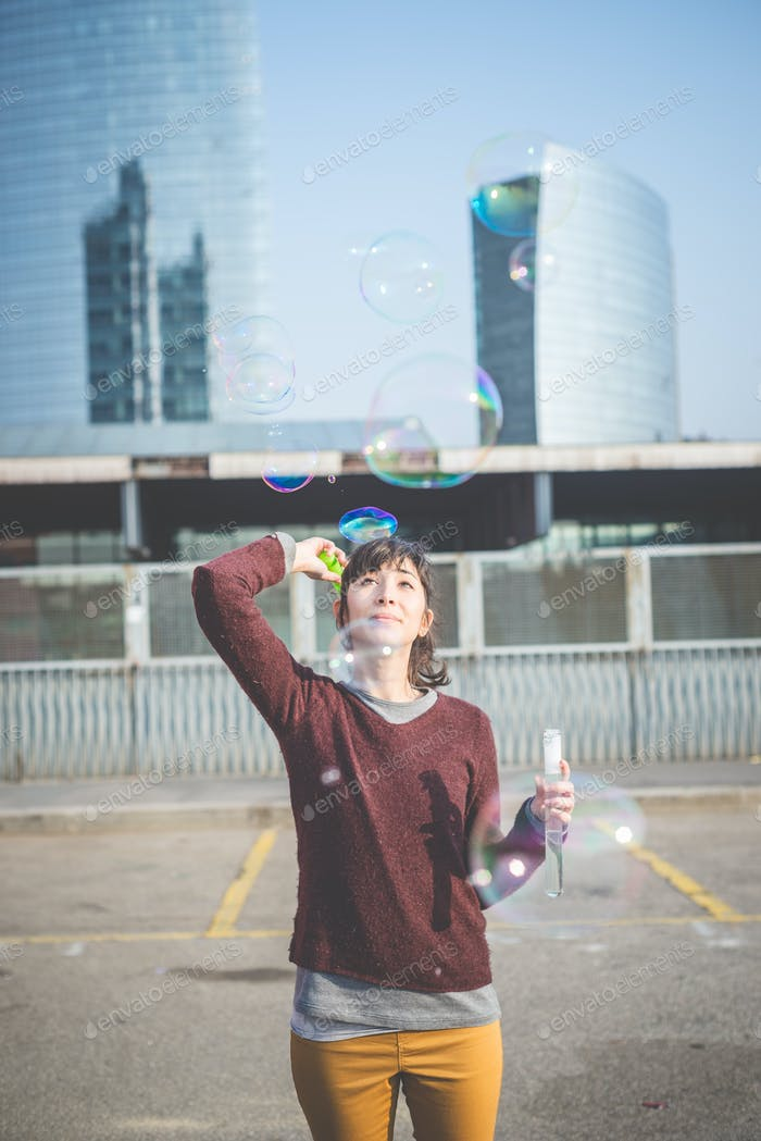 young beautiful hipster woman bubble blower