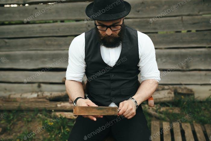 strong man sharpens old razor