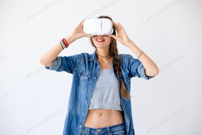 Joyful girl using VR device