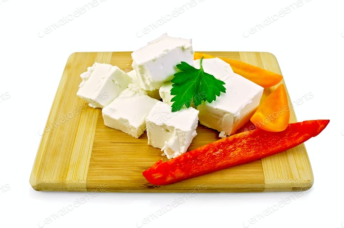 Feta cheese pieces with colored peppers