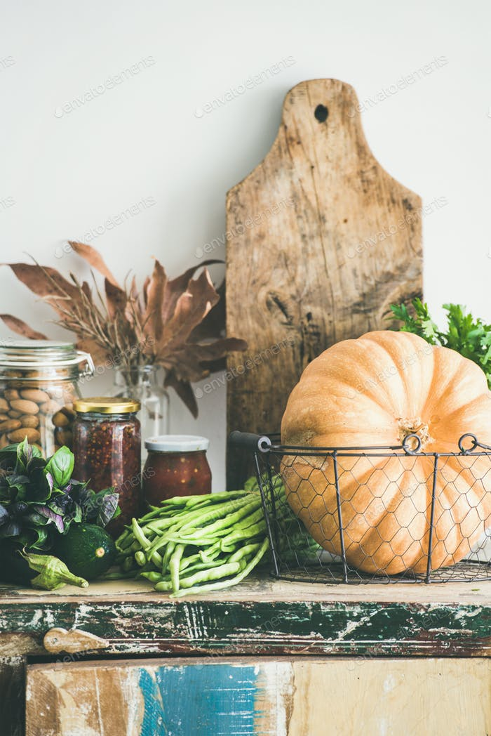 Autumn food ingredients and utensils over cupboard chest