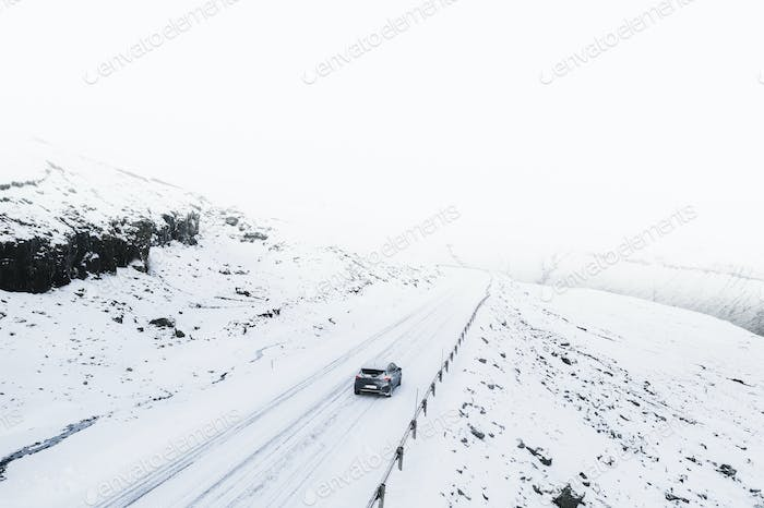 View of a road and fields covered in snow