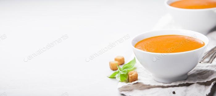 Homemade tomato soup (or gazpacho) over concrete background