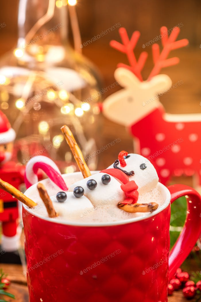 Marshmallow Snowman Melting in Hot Chocolate in Red Festive Cup
